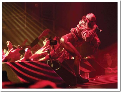 Yolandi gives (and gets!) some butt loving during Die Antwoords' recent Canadian concert (img src=Ion Magazine)